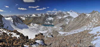Ala Archa in Kyrgyzstan. Scenic panorama of lake below highest mountain peaks in Ala Archa national park in Tian Shan mountain range in Kyrgyzstan royalty free stock photo