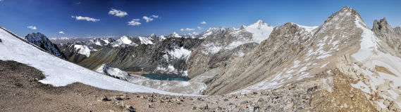 Ala Archa in Kyrgyzstan. Scenic panorama of lake below highest mountain peaks in Ala Archa national park in Tian Shan mountain range in Kyrgyzstan royalty free stock image
