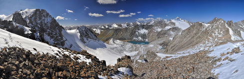Ala Archa in Kyrgyzstan. Scenic panorama of lake below highest mountain peaks in Ala Archa national park in Tian Shan mountain range in Kyrgyzstan royalty free stock photography