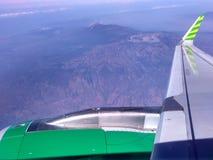 Ala del avión con el cielo nublado Fotografía de archivo libre de regalías