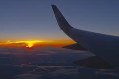 Ala di aereo al tramonto Fotografie Stock