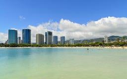 Ala moana beach. And office buildings on shore Royalty Free Stock Photography