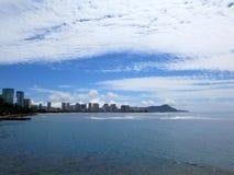 Ala Moana Beach Park with buildings of Honolulu, Waikiki and ico. Nic Diamondhead in the distance during a beautiful day on the island of Oahu, Hawaii Stock Photos