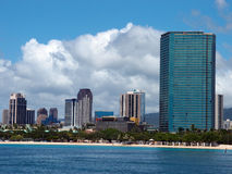 Ala Moana Beach Park with office building and condos in the back. Ground during a beautiful day on the island of Oahu, Hawaii Royalty Free Stock Photography