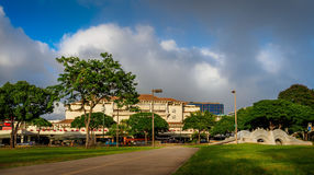 Ala Moana Shopping Center from public park. Ala Moana Shopping Center viewed from the Ala Moana public park. Image shows a cloudscape that was fast changing Royalty Free Stock Images