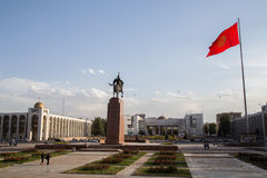 Ala-Too Square Bishkek. Photograph of the Ala-Too Square in Bishkek, Kyrgyzstan with the Erkindik statue and the officiel state flagpole stock photography