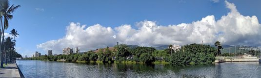 Ala Wai Canal, Canoes, hotels, Condos, Golf Course and Coconut t royalty free stock image