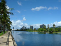 Ala Wai Canal, hotels, Condos, Golf Course and Coconut trees on Royalty Free Stock Photography