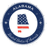 Alabama circular patriotic badge. Grunge rubber stamp with USA state flag, map and the Alabama written along circle border, vector illustration Royalty Free Stock Image