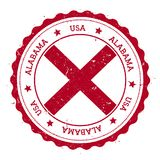 Alabama flag badge. Grunge rubber stamp with Alabama flag. Vintage travel stamp with circular text, stars and USA state flag inside it. Vector illustration Royalty Free Stock Images