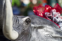 Alabama Football Pachyderm Mascot. This is a statue of Alabama elephant all dressed up for the holiday season with Bear Bryant hounds tooth and crimson bows stock image