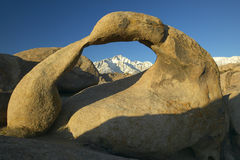The Alabama Hills Arch framing Mount Whitney and the snowy Sierra Mountains at sunrise near Lone Pine, CA Royalty Free Stock Images