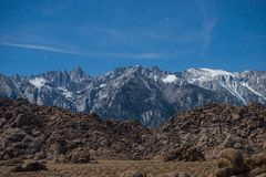 Panorama of Sierra Nevada Mountains at Night Under Moon Light In Alabama Hills, Lone Pine, California. The Alabama Hills are a range of hills and rock formations Stock Photography
