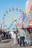Alabama National Fair midway. Montgomery, Alabama, USA - October 29, 2017: A view down the midway of the Alabama National Fair with the Farris Wheel in the Royalty Free Stock Photography