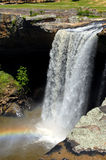 Alabama's Noccalula Falls. Alabama's gorgeous, Noccalula Falls plummets 100 foot over a rocky ledge.  Rainbow is caught in the spray at bottom of falls Royalty Free Stock Photos