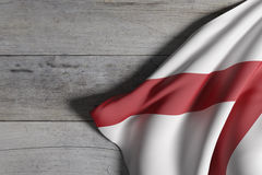 Alabama State flag. 3d rendering of an Alabama State flag on a wooden surface Royalty Free Stock Photo