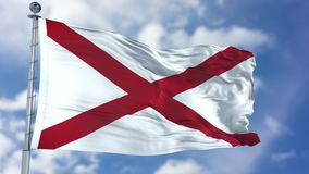 Alabama Waving Flag. Alabama U.S. state flag waving against clear blue sky, close up, isolated with clipping path mask luma channel, perfect for film, news Royalty Free Stock Photography