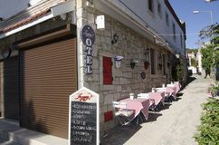 In Alacati there are cafes, covered and food menues in front of the hotels Royalty Free Stock Images