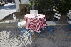 Alacati turquoise tablecloths, blue chairs, all alacaty classic Stock Image