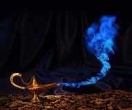Aladdin genie lamp - no genie. Magic Aladdin genie lamp with blue smoke, but no genie face Stock Photos