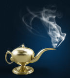 Aladdin magic lamp on black with smoke Royalty Free Stock Image