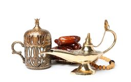 Aladdin magic lamp, dates and beads. On white background royalty free stock images