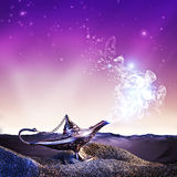 Aladdin magic lamp. Magic aladdin lamp in the desert at night time royalty free stock photography