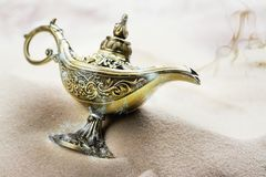 Aladdin magic lamp on the sand. Copy space Royalty Free Stock Images