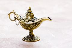 Aladdin magic lamp on the sand. Copy space Stock Photography