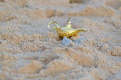 Aladdin`s lamp in the sand Stock Photo
