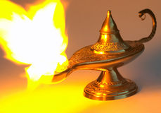 Aladdin's lamp - yellow version. Yellow version of Aladdin's lamp - this is the traditional Arabian brass lamp, which is the stuff of legend stock photo