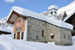 Alps winter church. Valsesia dOtro Alps church in winter Stock Image