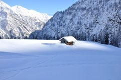 Alps winter chalet. Valsesia Alps winter landscape, typical chalet Stock Photos