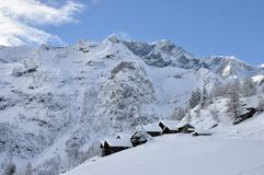 Alagna Alps winter mountain village. Valsesia Alps dotro winter landscape, typical village Stock Photos