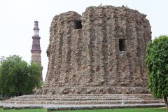 Alai Minar and Qutab Minar, Delhi, India. Alai Minar with Qutab Minar in the background in Delhi, India. It is a minaret, the construction was abandoned, that stock images