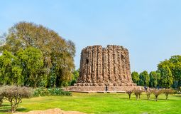 Alai Minar, an uncompleted minaret at the Qutb complex in Delhi, India. Alai Minar, an uncompleted minaret at the Qutb complex in Delhi. World heritage site in stock photo