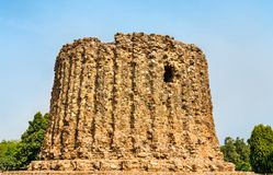 Alai Minar, an uncompleted minaret at the Qutb complex in Delhi, India. Alai Minar, an uncompleted minaret at the Qutb complex in Delhi. World heritage site in Royalty Free Stock Photo