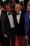 Alain Prost y Jackie Stewart y Helen Stewart Foto de archivo libre de regalías