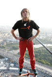 Alain Robert on top of skyscraper Royalty Free Stock Photo