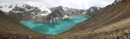 Alakol lake in Kyrgyzstan, Tian Shan mountains Royalty Free Stock Photography