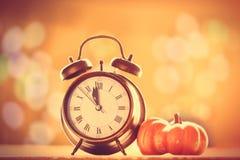 Alalrm clock and pumpkin Stock Photography