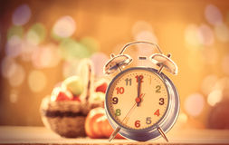 Alalrm clock and pumpkin Royalty Free Stock Photography