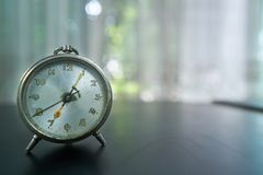 Alam clock, early in the morning with bokeh stock image