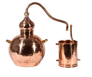 Alambic. An alembic from Arabic الإنبيق al-anbīḳ; from Greek ἄμβιξ ambix, meaning `cup, beaker` is an alchemical still consisting of two vessels Stock Image