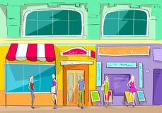 Alameda de compras que construye a gente exterior de la tienda Imagen de archivo