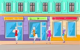 Alameda de compras que construye la tienda exterior de la mujer de la moda Foto de archivo libre de regalías