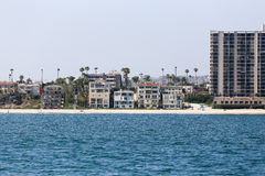 Alamitos Beach. Long Beach, USA - June 7, 2014: Alamitos Beach seen from the ocean. There are houses, an apartment block, a lifeguard station and people Royalty Free Stock Images