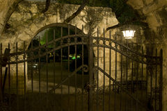 The Alamo Gate. A gate at the Alamo at night royalty free stock images