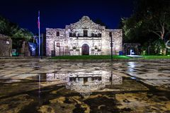 The Alamo in San Antonio, Texas during night after a rainfall wi. Th the building reflecting in water puddles stock photos