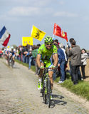 Alan Marangoni - Paris Roubaix 2014. Carrefour de l'Arbre,France-April 13,2014:The Italian cyclist Alan Marangoni from Garmin-Sharp Team riding on the famous Royalty Free Stock Photos